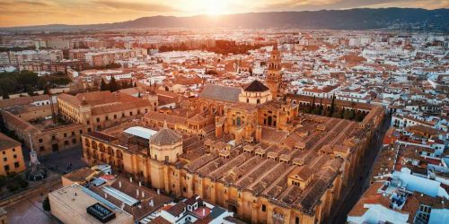 The Mosque–Cathedral of Córdoba aerial closeup view at sunset in Spain.